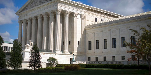 """FILE - In this Oct. 5, 2015 file photo, the Supreme Court is seen in Washington. President Donald Trump has said he plans to pick a young Supreme Court justice who could be on the court for 40 years or more. But other factors will also be in play as the candidates are vetted: their ideological bent, gender, ability to be confirmed and even whether they meet Trump's requirement that they be """"not weak.""""  (AP Photo/Carolyn Kaster, File)"""