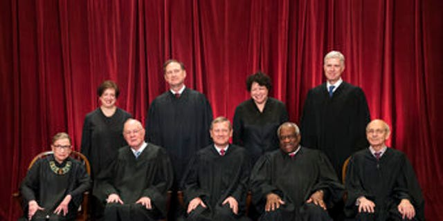 The justices of the U.S. Supreme Court gather on June 1, 2017, for an official group portrait: Seated, from left: Associate Justice Ruth Bader Ginsburg; Associate Justice Anthony M. Kennedy; Chief Justice John Roberts; Associate Justice Clarence Thomas and Associate Justice Stephen Breyer. Standing, from left: Associate Justice Elena Kagan; Associate Justice Samuel Alito Jr.; Associate Justice Sonia Sotomayor and Associate Justice Neil Gorsuch.