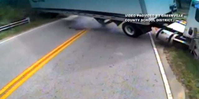 The semi-truck can be seen swerving out of control in this surveillance video.