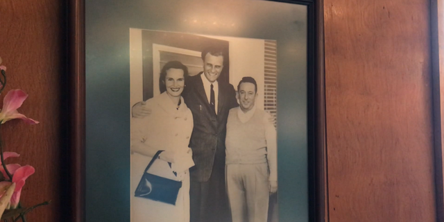 """Billy Graham and his wife Ruth with restaurant owner """"Red Bridges"""" in the late 50s."""