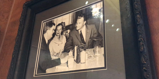 Billy Graham and his wife Ruth having lunch with Representative Basil Whitner (D-SC) in the late 50's. Shelby, NC