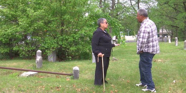 Yolanda Romero who serves on the Mount Peace Cemetery Association board speaks with volunteer.