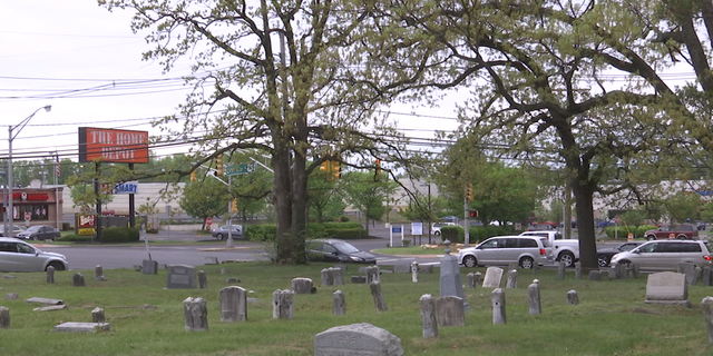 Mount Peace Cemetary covers more than 11 acres along a busy highway and strip mall.