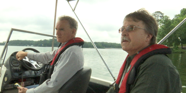 Wildlife biologists ride to the edge of Lake Jackson to check on a five-year old eagle nest.