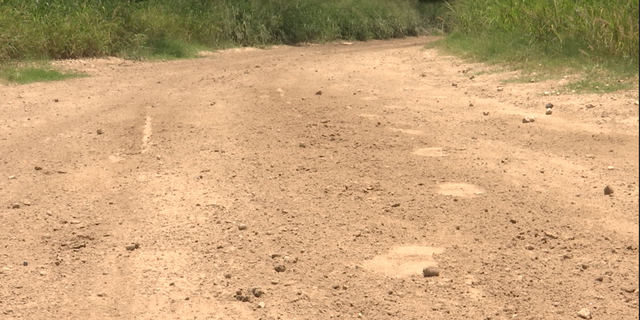A border patrol agent points out fresh footprints likely belonging to people illegally crossing the border.