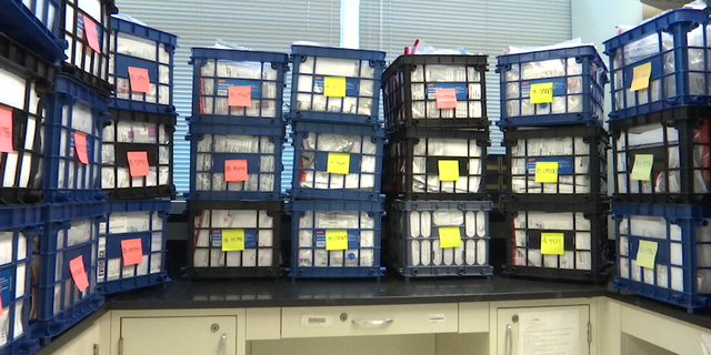 Crates of drug evidence awaiting analysis fill several rooms at GBI headquarters in Decatur, Ga.