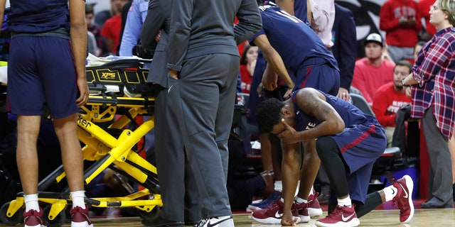 South Carolina State players react as Ty Solomon is attended to after he was injured during the first half of an NCAA college basketball game against North Carolina State at PNC Arena in Raleigh, N.C., Saturday, Dec. 2, 2017
