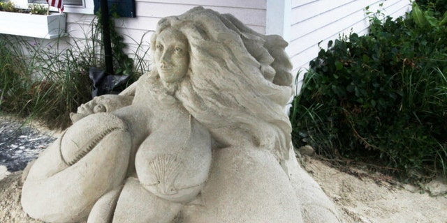 This July 7, 2016 photo shows the mermaid sand sculpture in front of Salty's Seafood Restaurant in West Yarmouth, Mass. Here, the sand sculpture is under a small tent enclosure outside the restaurant and is part of a larger collection of sculptures throughout Yarmouth.