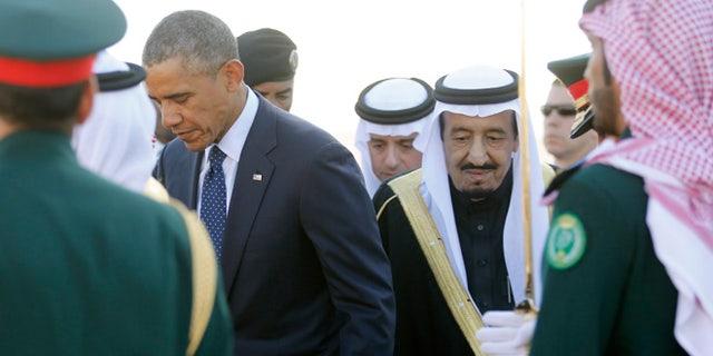Jan 27: President Obama is greeted by Saudi Arabia's King Salman as he arrives at King Khalid International Airport in Riyadh.