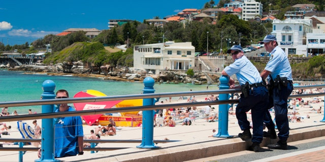 Two police officers watch over the beach at Coogee, Sydney. A heightened police presence was seen on NSW beaches following an event known as the 2005 Cronulla riots which were racialy linked.