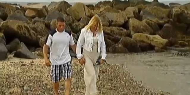 UNDATED: Mark Hodgdon, left, and his fiancee, Mary, could face a $5,000 fine for trying to help an injured baby seal at a beach in Marshfield, Mass., MyFoxBoston.com reported.