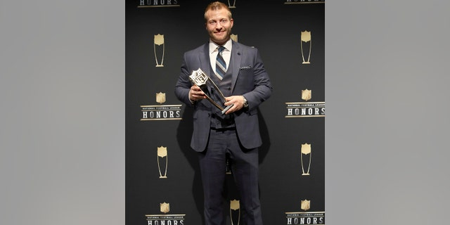 Los Angeles Rams coach Sean McVay poses in the press room with the award for The Associated Press 2017 NFL Coach of the Year at the 7th in the press room at the 7th Annual NFL Honors at the Cyrus Northrop Memorial Auditorium on Saturday, Feb. 3, 2018, in Minneapolis.