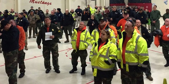 Law enforcement volunteers receive assignments Sunday Jan. 17, 2016, in search for missing 2-year-old. (TBI)