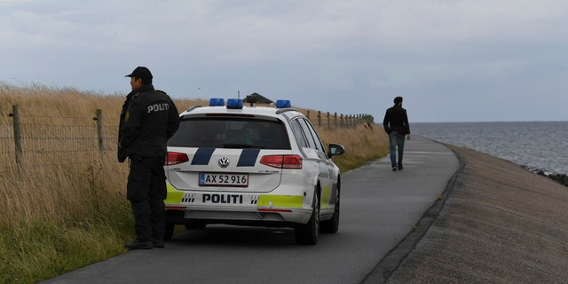 Police officers on the south coast of the isle of Amager, near Copenhagen, Denmark, Monday Aug. 21, 2017.
