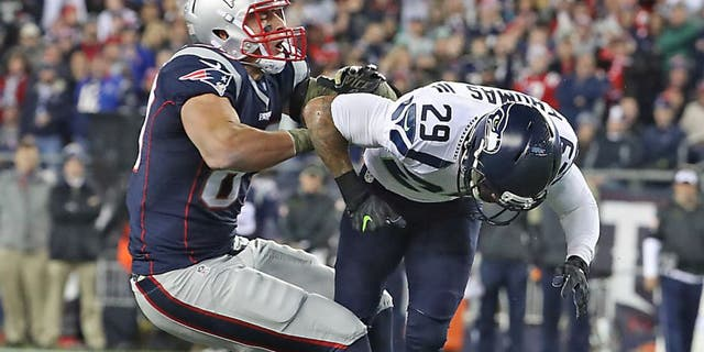 FOXBOROUGH, MA - NOVEMBER 13: New England Patriots Rob Gronkowski is hit by Seattle Seahawks Earl Thomas III forcing an incomplete pass during second quarter. The New England Patriots host the Seattle Seahawks at Gillette Stadium in Foxborough, Mass., on Nov. 13, 2016. (Photo by Matthew J. Lee/The Boston Globe via Getty Images)