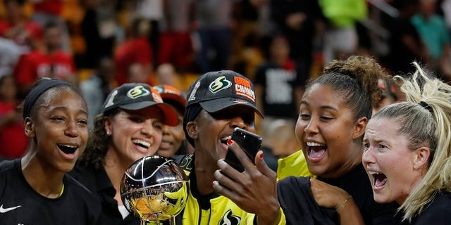 Members of the Seattle Storm are seen celebrating their WNBA championship.