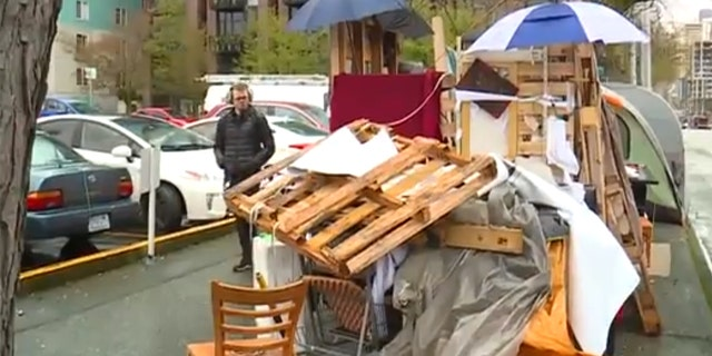 """The homeless """"mansion"""" was put together with whatever items people could scrounge together."""