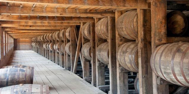 Whisky barrels on racks in the barrel house