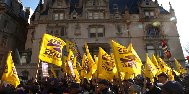 Members of the Service Employees International Union (SEIU) at a protest in support of a new contract for apartment building workers in New York City in 2014.