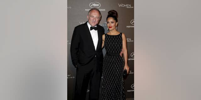 French billionaire François-Henri Pinault, who is married to Salma Hayek, pledged $113 million toward reconstruction efforts after a fire ravaged Paris' Notre Dame cathedral, causing substantial damge and the collapse of the structure's main spire.