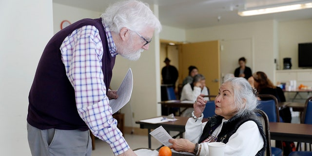 Patrick Arbore, left, talks to Corazon Leano as he conducts an anti-bullying class at the 30th Street Senior Center in San Francisco, April 13, 2018.