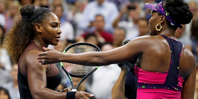 Serena Williams, left, meets her sister Venus Williams after their match during the third round of the U.S. Open tennis tournament, in Flushing, N.Y., Aug. 31, 2018.