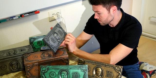 The former hacker is now producing souvenir dollar bills with Putin's face on them. They are actually metallic bricks – a bit of shelf candy. He is looking to do a little crowd-funding for his venture.