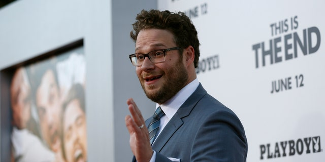 "June 3, 2013. Director, writer and cast member Seth Rogen waves at the premiere of ""This Is the End"" at the Regency Village Theatre in Los Angeles, California."