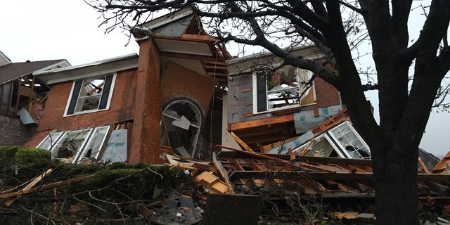A damaged house is seen after a tornado struck Rowlett, Texas on Saturday.