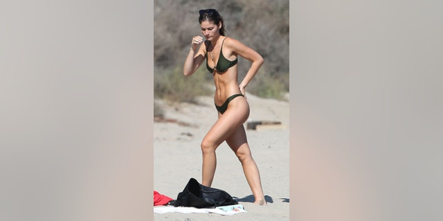 Playboy model Shauna Sexton enjoyed a day at the beach while her rumored beau Affleck made his way to rehab.