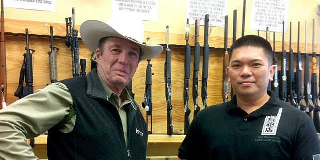 Retired Texas Sheriff Jim Wilson, (l.), visited the gunshop when he went to San Francisco.