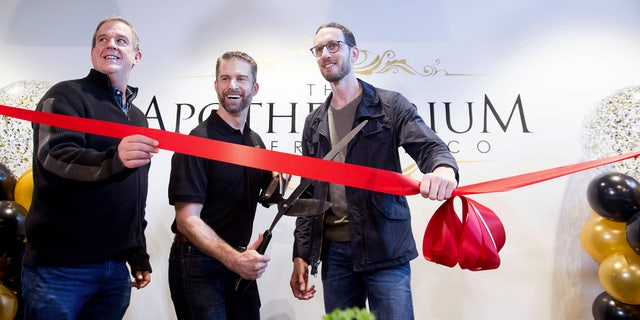 California State Sen. Scott Weiner, right, celebrates the opening of The Apothecarium for recreational marijuana sales in San Francisco on Saturday, Jan. 6, 2018. Joining him are The Apothecarium co-founder and CEO Ryan Hudson, center, and San Francisco Supervisor Jeff Sheehy