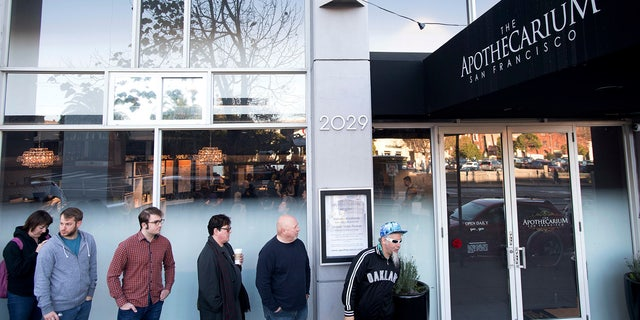 Customers wait for the opening of recreational marijuana sales at The Apothecarium on Saturday, Jan. 6, 2018, in San Francisco.