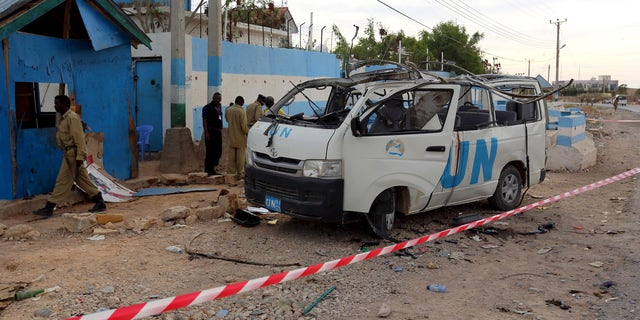 A U.N. van is seen damaged by an improvised explosive device (IED) outside the U.N. compound in Garowe, the administrative capital of Somalia's semi-autonomous Puntland, April 20, 2015.