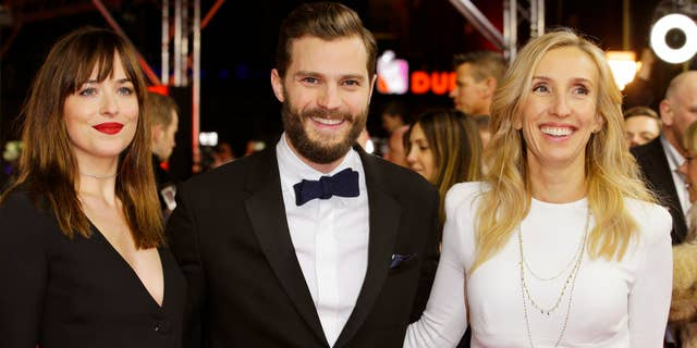 Feb. 11, 2015: Actress Dakota Johnson, actor Jamie Dornan and director Sam Taylor-Johnson, from left, pose for photographers on the red carpet for the world premiere of Fifty Shades of Grey at the 2015 Berlinale Film Festival in Berlin.