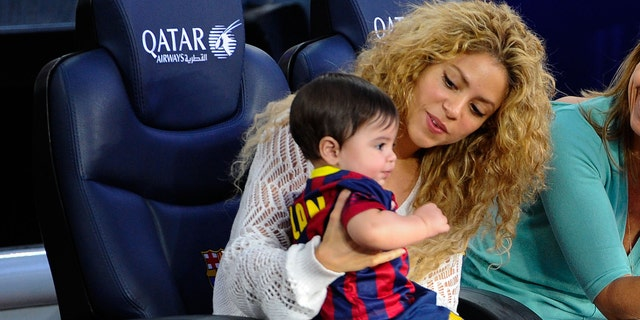 BARCELONA, SPAIN - SEPTEMBER 14:  Shakira and Montserrat Bernabeu, Gerard Pique's mother, play with Milan prior to the La Liga match between FC Barcelona and Sevilla FC at Camp Nou on September 14, 2013 in Barcelona, Spain.  (Photo by David Ramos/Getty Images)