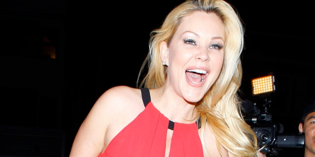 Shanna Moakler smiled for photos at Cheryl Burke's birthday party, held at the Emerson nightclub. Shanna was sporting black pants and a bright pink top, on Friday, May 3, 2013.