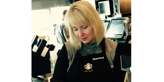 Shannon Feltz, a military spouse, serves coffee at the new Starbucks Military Family Store in Clarksville, Tenn.