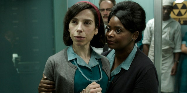 """This image released by Fox Searchlight Pictures shows Sally Hawkins, left, and Octavia Spencer in a scene from the film """"The Shape of Water."""" On Monday, Dec. 11, 2017, Hawkins was nominated for a Golden Globe for best actress in a motion picture drama for her role in the film."""
