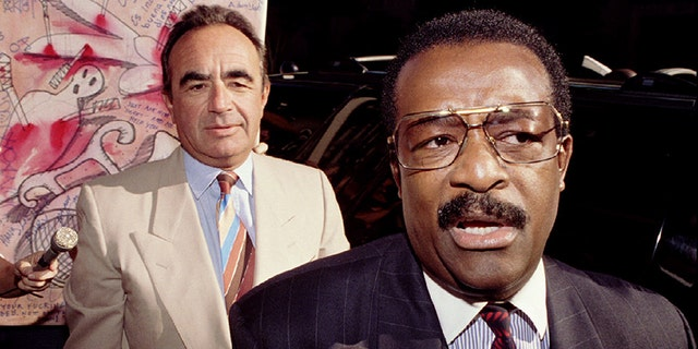 Defense attorneys Robert Shapiro, left, and Johnnie Cochran arrive at the Criminal Courts Building in Los Angeles September 26 for the first day of jury selection in the O.J. Simpson murder trial.