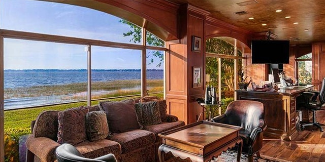 The stunning property boasts sprawling waterfront views.