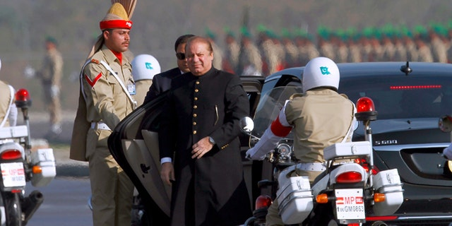 Pakistan's prime minister Nawaz Sharif, center, arrives to attend a military parade to mark Pakistan's Republic Day, in Islamabad, Pakistan, Thursday, March 23, 2017.