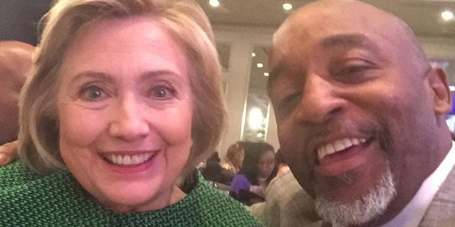 Kenneth Glasgow, right, is seen with former Democratic presidential candidate Hillary Clinton.