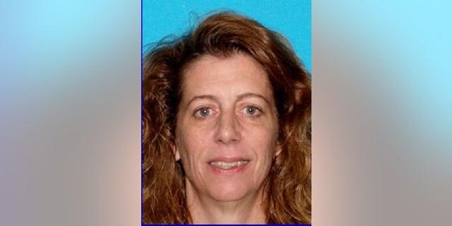 Authorities in Maine say Carol Sharrow, 51, drove onto a baseball diamond Friday night, killing a man.