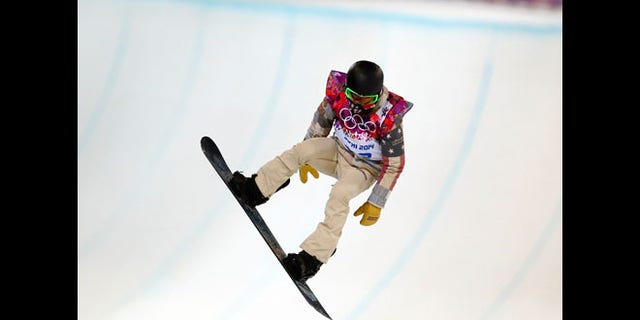 Feb. 10, 2014: Shaun White of the United States gets air during a snowboard half pipe training session at the Rosa Khutor Extreme Park at the 2014 Winter Olympics in Krasnaya Polyana, Russia.