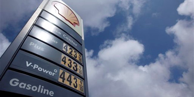 The price board at a Shell gas station is shown in San Francisco April 11.