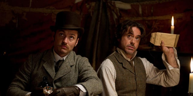 """Robert Downey, Jr., right, and Jude Law star as Sherlock Holmes and Dr. Watson in """"Sherlock Holmes: A Game of Shadows."""" (Warner Bros. 2011)"""