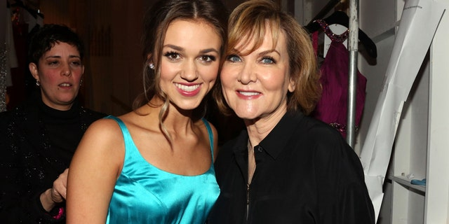Sadie Robertson (L) and fashion designer Sherri Hill attend the Sherri Hill fall 2015 fashion show at The Plaza Hotel on February 19, 2015, in New York City.