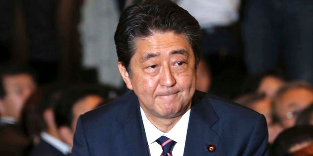 Liberal Democratic Party President Shinzo Abe receives applause from the LDP lawmakers shortly after his name was called as the winner of the ruling party presidential elections at its headquarters in Tokyo, Sept. 20, 2018.