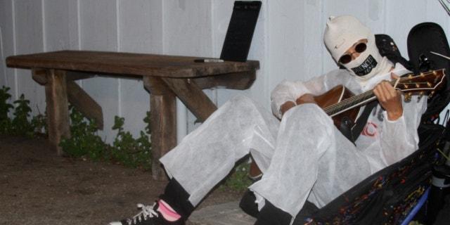 March 28, 2013: Alternative folk singer Michelle Shocked sits outside Moe's Alley nightclub in Santa Cruz Calif., and strums her guitar.